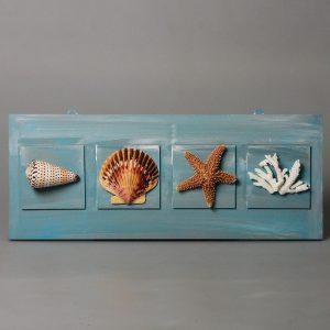 Quadro con stella marine, conchiglie e corallo