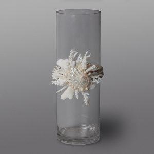 Cilindro in vetro con cima marinara e coralli